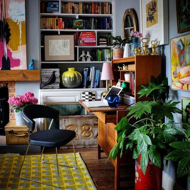 Home office with shelves full of colorful curiousities