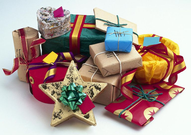 Pile of gift wrapped presents with ribbons and bows