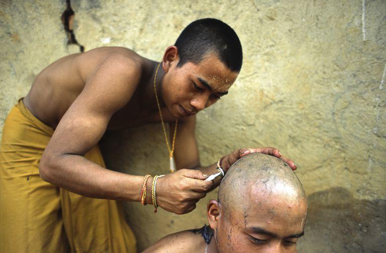 China - Yunnan - Xishuangbanna - A Monks Gets His Head Shaven