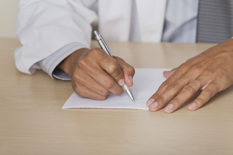 Doctor writing prescription, cropped