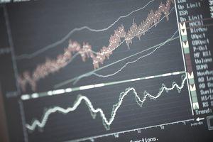 Computer screen displays laptop graph of financial trends.
