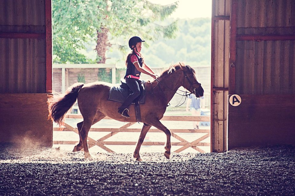 Girl riding pony