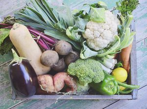 Organic vegetables in a wooden crate