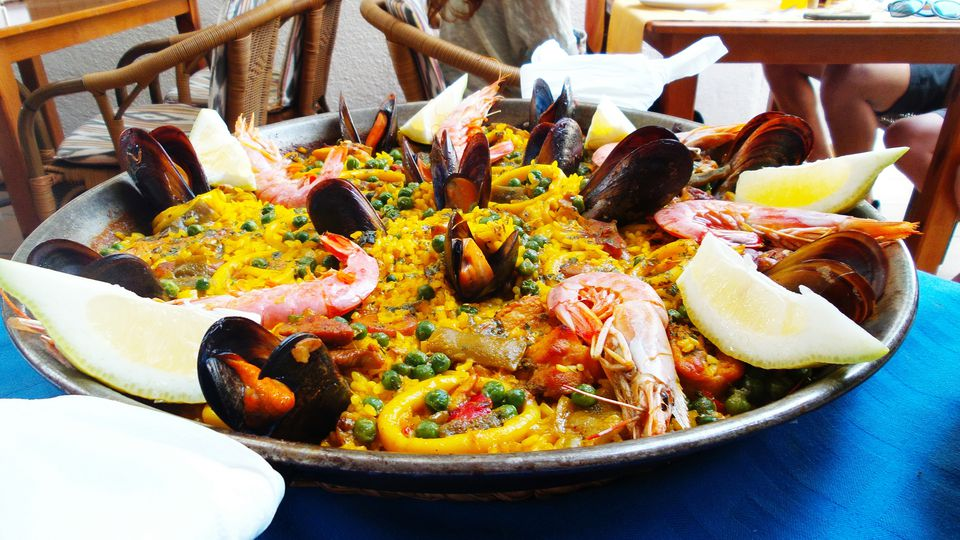 Close-Up Of Paella In Plate On Table