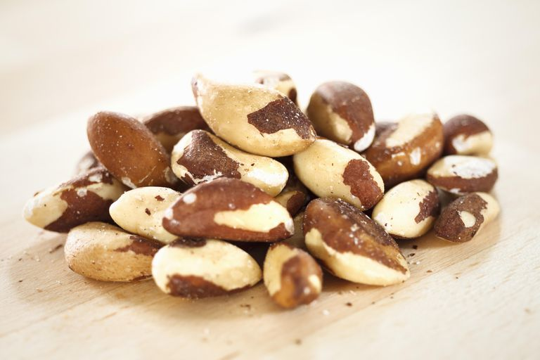 Pile of fresh Brazil nuts on a wooden table