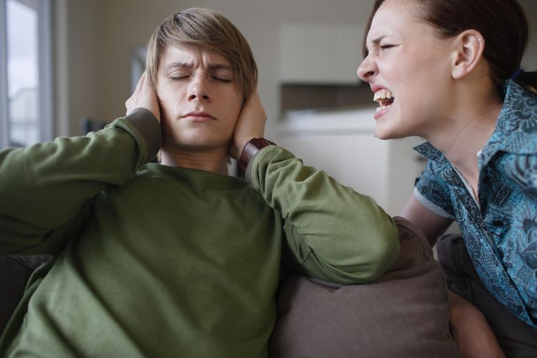 Young woman yelling at young man covering ears