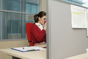 woman partially behind cubicle partition