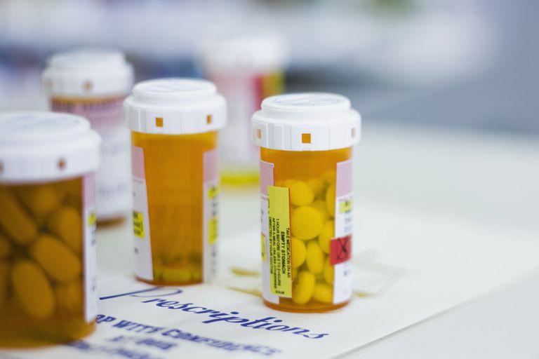 Multiple prescription pill bottles.