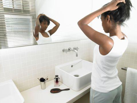 Woman thinking of transitioning to natural hair