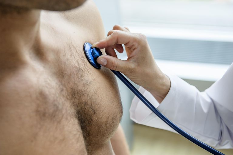 Female doctor examining patient with stethoscope