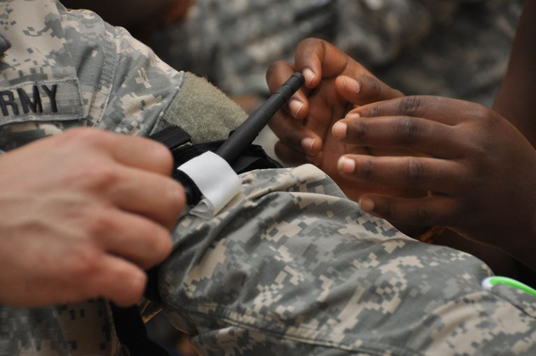 US Army soldiers training in Ghana practice applying tourniquets.