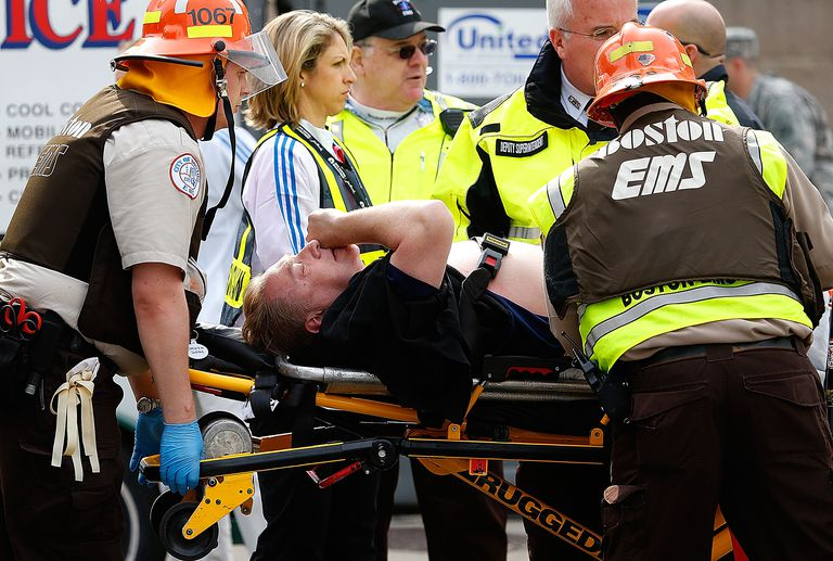 Victims of the Boston Marathon bombing getting medical aid.