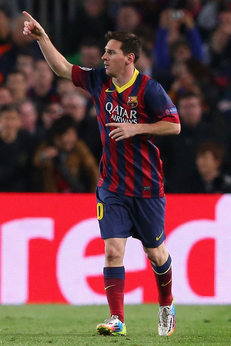 BARCELONA, SPAIN - MARCH 12: Lionel Messi of FC Barcelona celebrates after scoring the opening goal during the UEFA Champions League Round of 16 match between FC Barcelona and Manchester City at Camp Nou on March 12, 2014 in Barcelona, Spain.