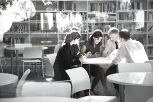 a group of colleagues meeting at a conference table