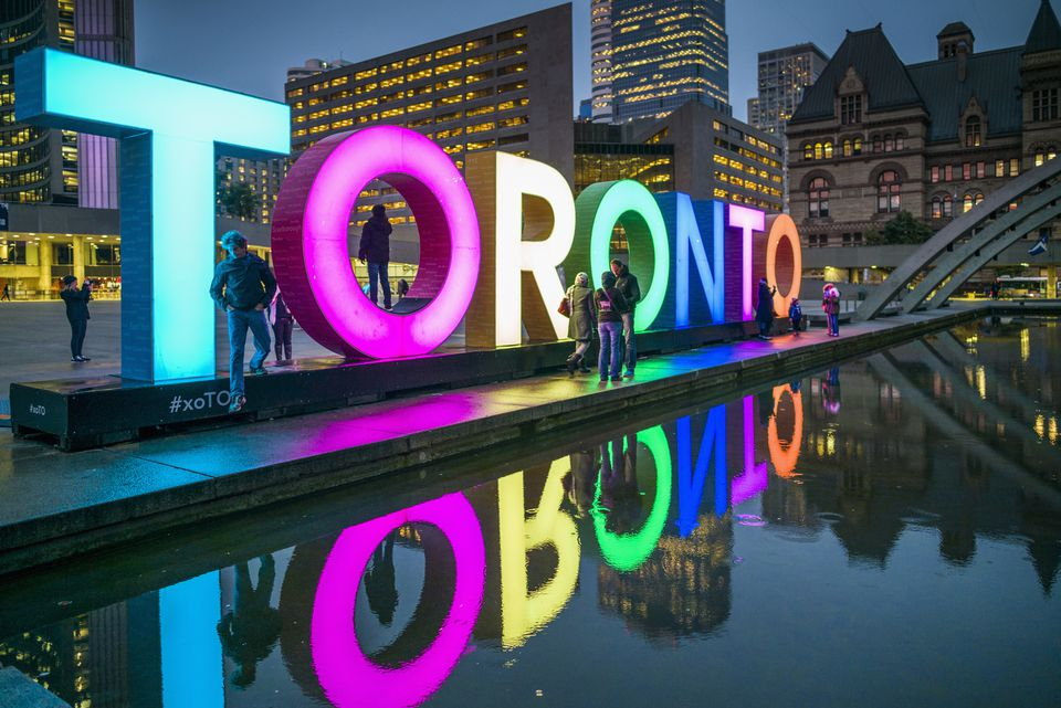 Canada, Ontario, Toronto, Toronto Sign in Nathan Phillips Square by the City Hall, dusk