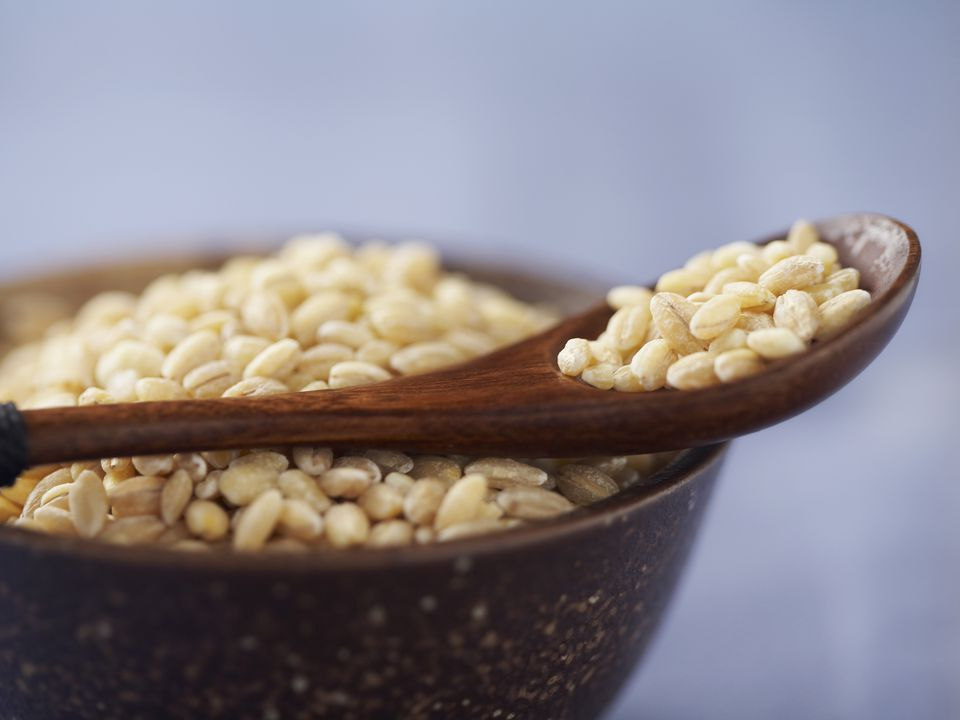 Pearl barley with spoon and bowl