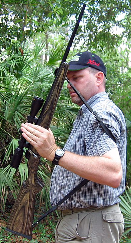 How to use a rifle sling. One-handed rifle sling carry provides great control and excellent safety.
