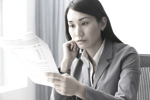 Businesswoman reading report