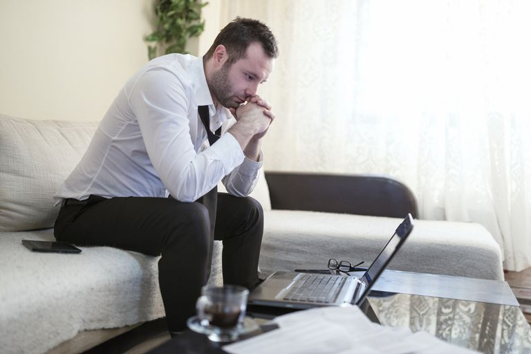 Worried Businessman in Charge of the Home Finance Problems
