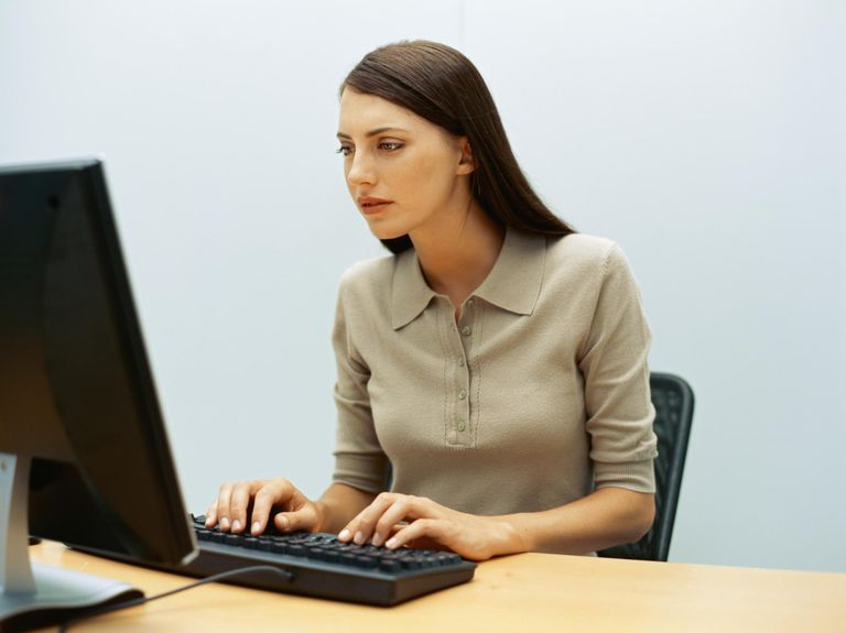 Businesswoman using a computer in an office