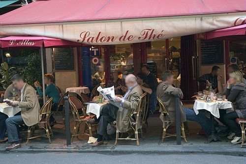 Tea or coffee and a newspaper, anyone? Yes, they do have tea room cafes in Paris.