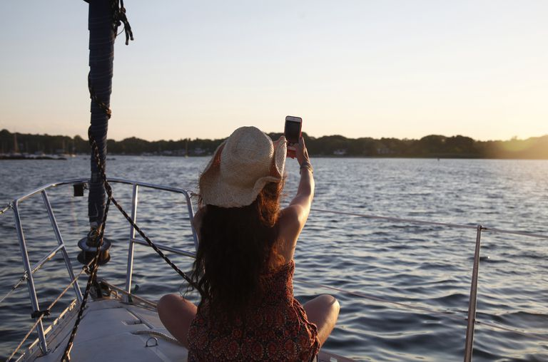 woman taking a selfie on a sailboat