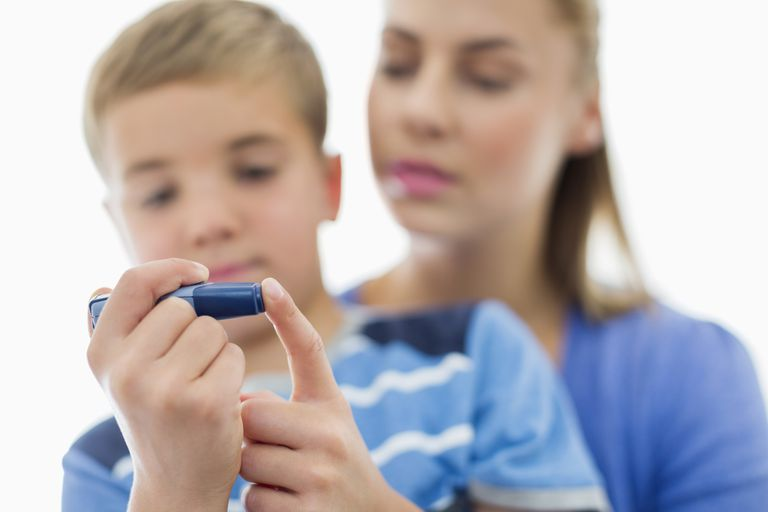 A child testing his blood sugar level.