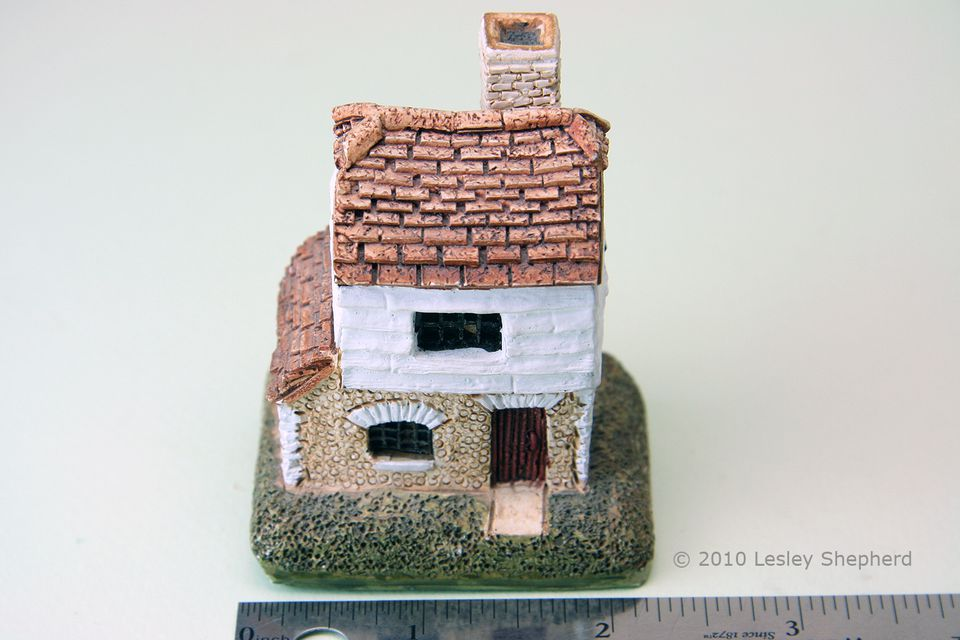 """Front view of the Lilliput Lane collectible cottage """"Millers""""."""