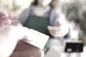 A hand passing a credit card