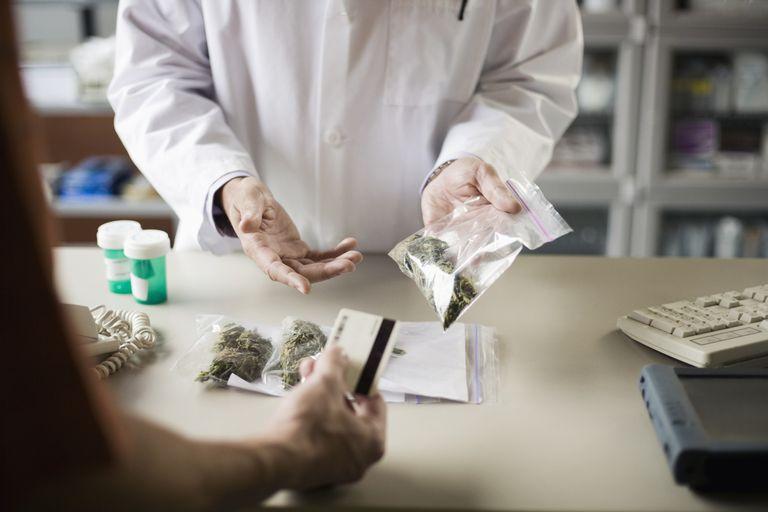 Pharmacist holding bag of medical marijuana
