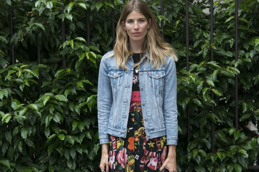 Woman in jean jacket and skirt