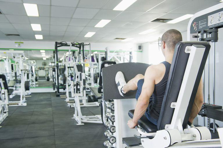 Man using a leg press in a gym