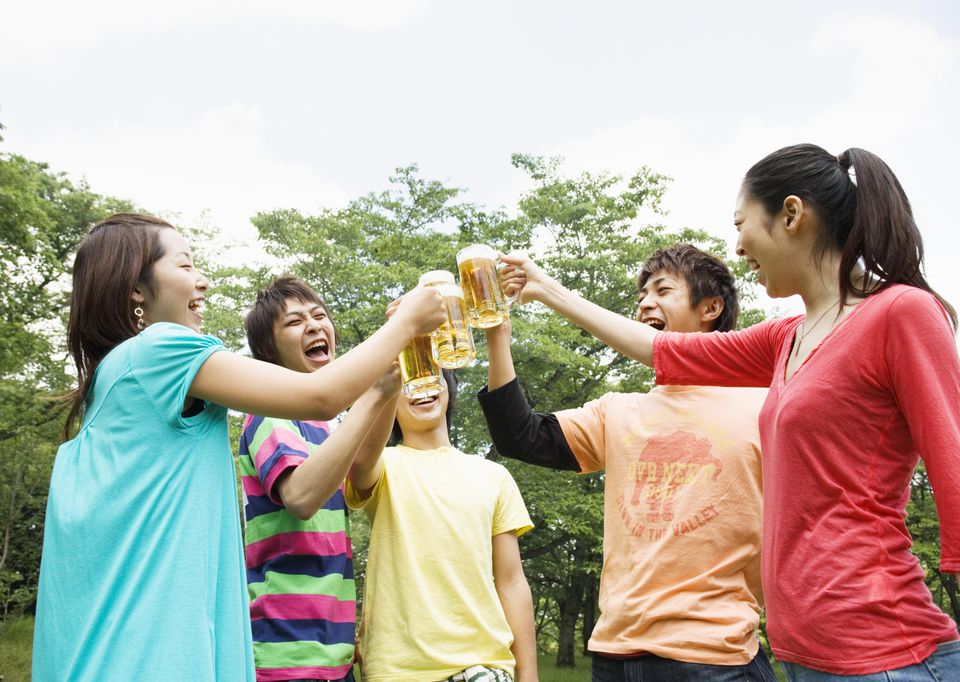 Young people making a toast with beer