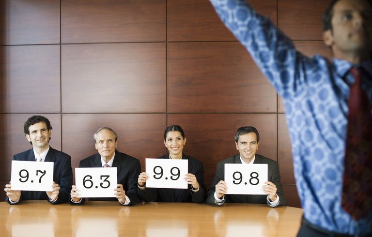 Businesspeople Judging Performance
