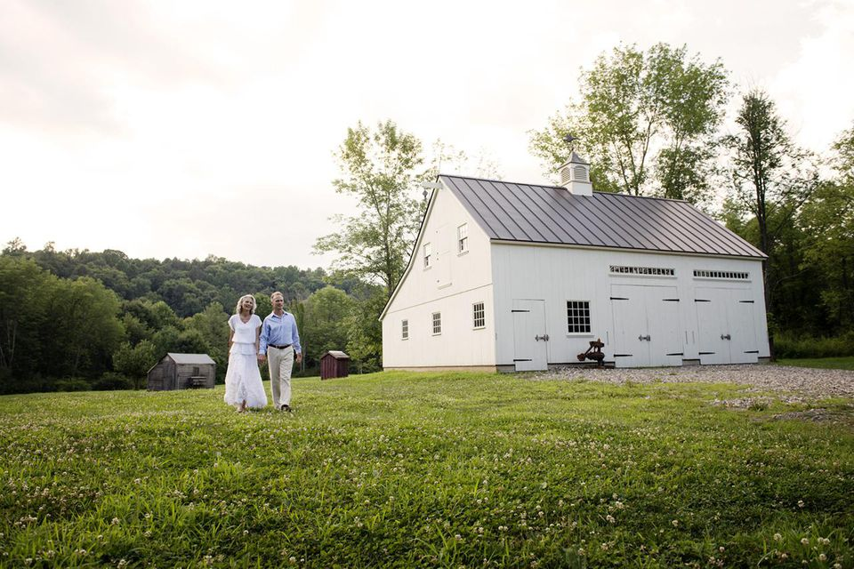 Senior Couple Walking on Farmhouse Grounds