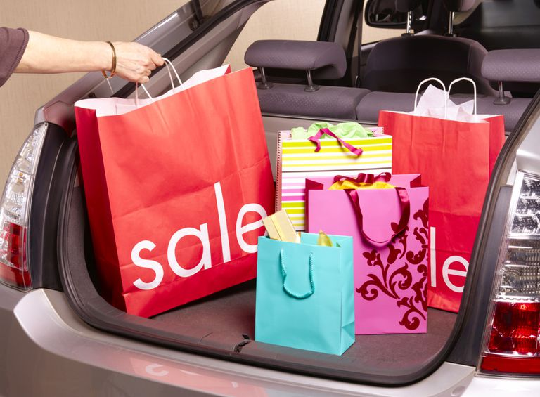 shopping bags in back of car