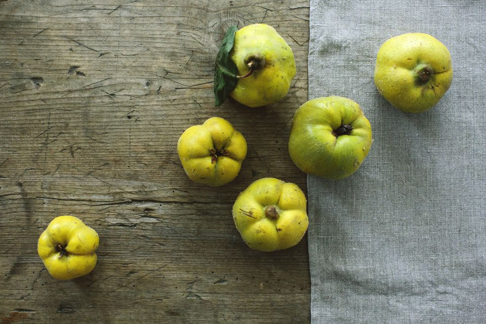 Quince fruit on a wooden table