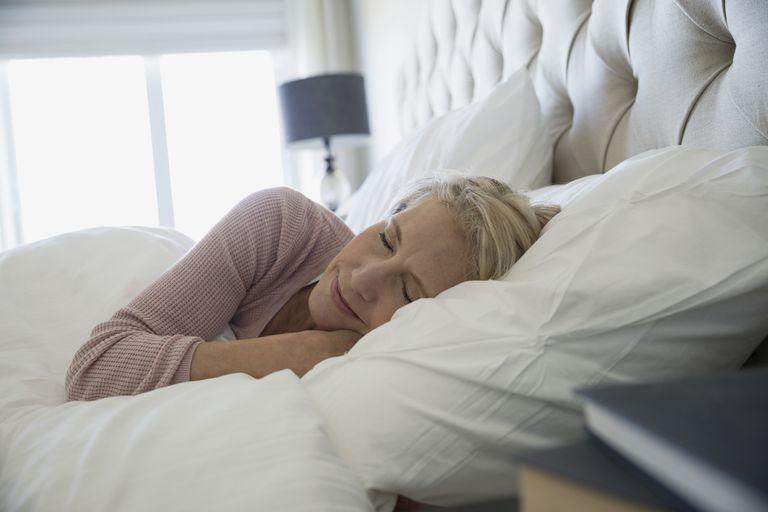 Comfortable woman sleeping in bed