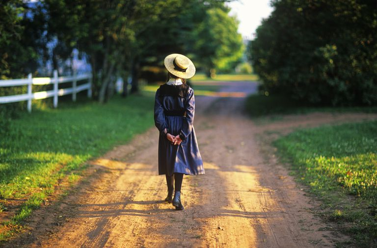 Anne of Green Gables actor walking down country road, Prince Edward Island, Canada.