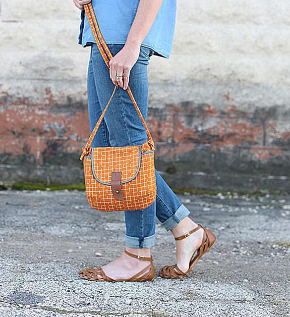A woman holding a bag.