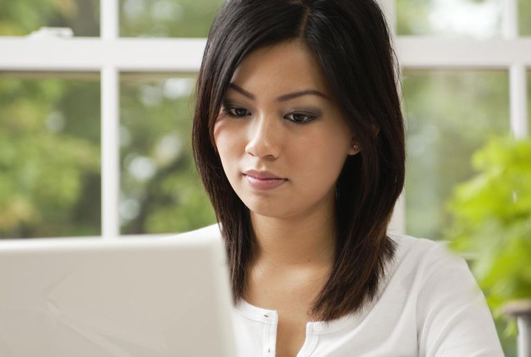 A young woman concentrating on her laptop computer