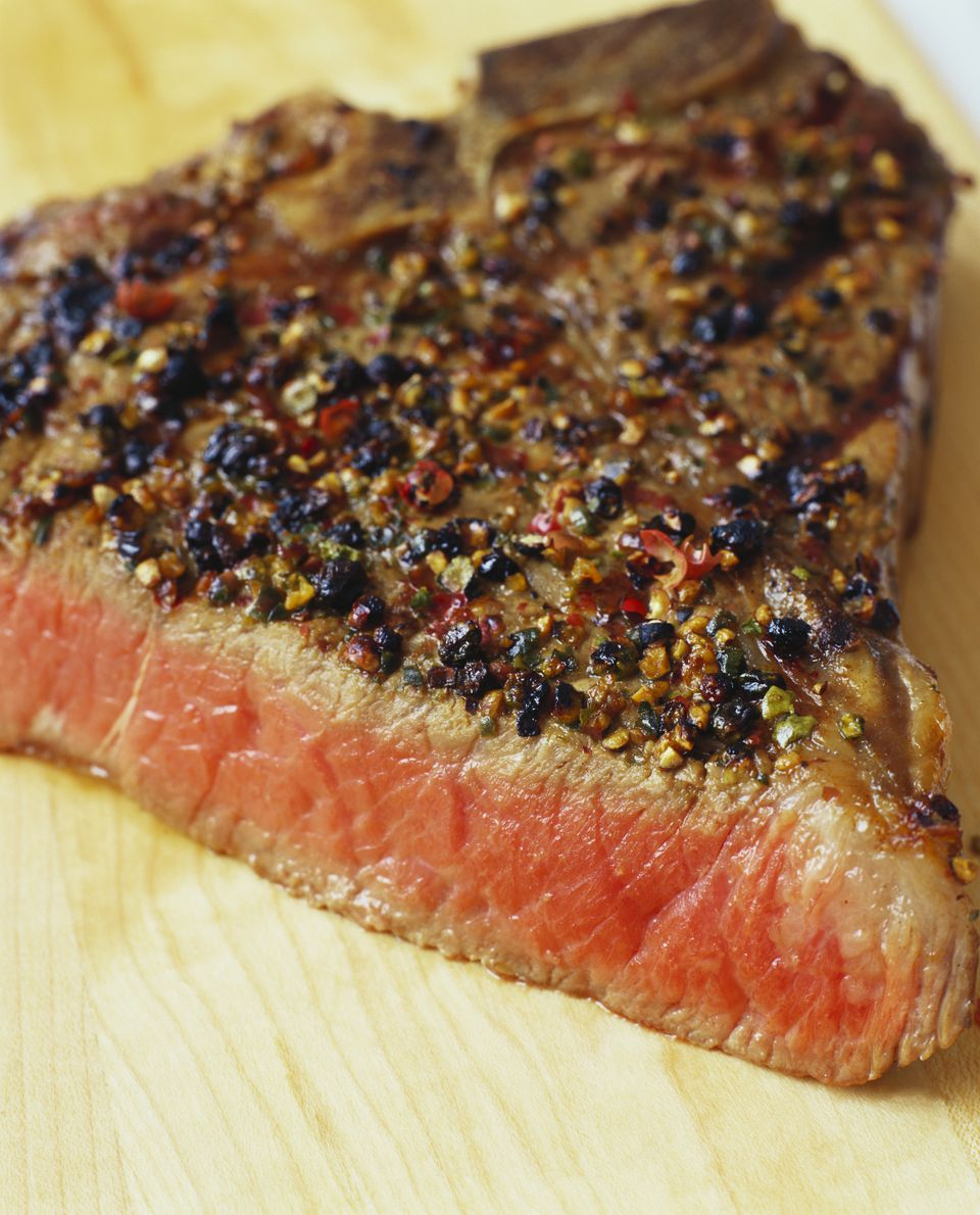 Slice of steak with pepper close up