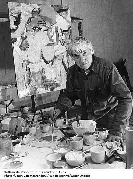 Artist Willem de Kooning painting in his studio in in 1967.