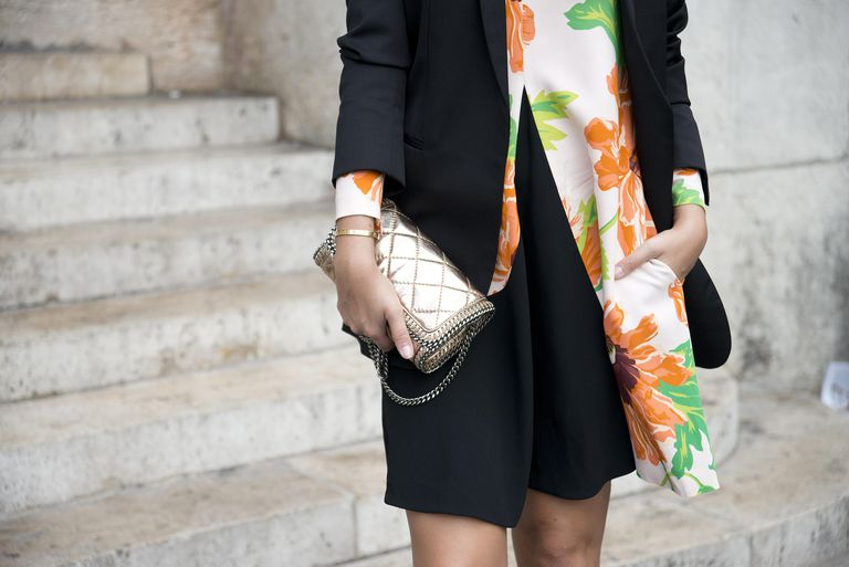 Woman holding metallic handbag