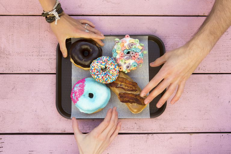 Specialty doughnuts on a tray.