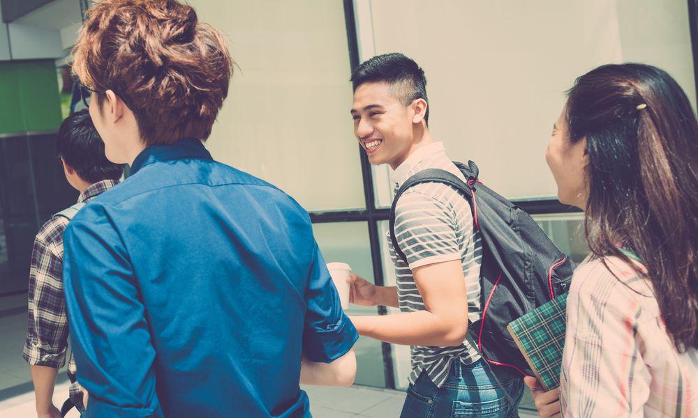 teens walking into school