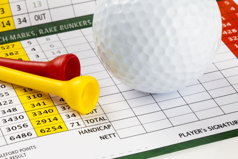 golf scorecard with ball and tees