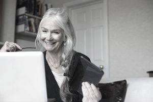 Senior woman using laptop to check on her variable annuity.