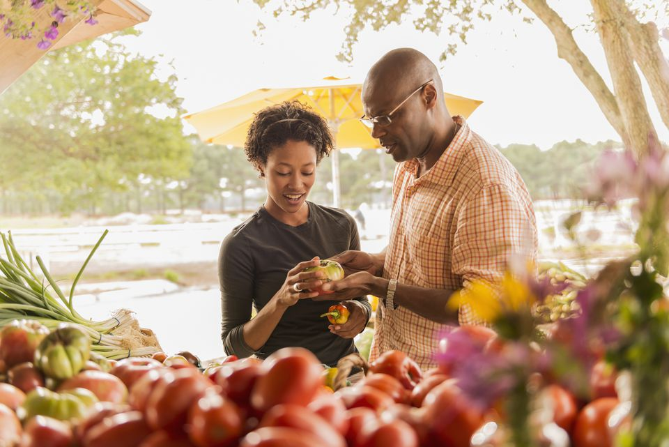 Couple buying produce at farmers market