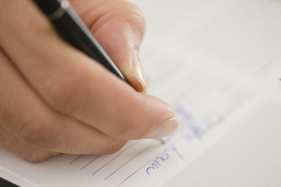Close up of woman writing